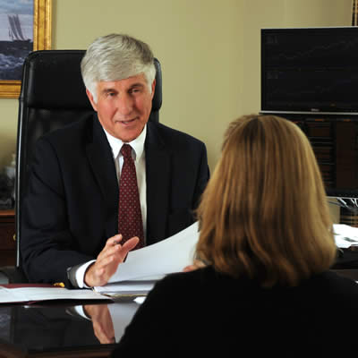 Herb Diamant speaking with a female client in his office